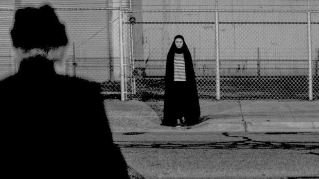 girl walks home at night
